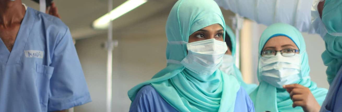 Yemen hospital staff in centre CROPPED