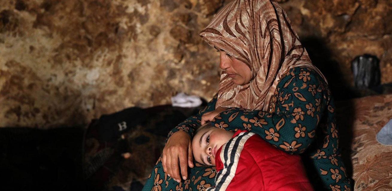 moeder-met-kind-Syrie-compressor